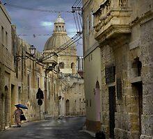 Siggiewi Malta --- Walking in the Rain by Edwin  Catania