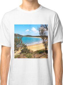 Idyllic bay seen through trees Classic T-Shirt