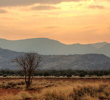 Dusty Sunset over Amata by Roger Neal