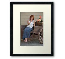 Women in old cart Framed Print