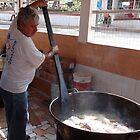 Preparing carnitas for tacos by Bernhard Matejka