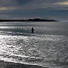 Lone fisherman at Fisherman's Beach, Torquay, Victoria by Crystallographix