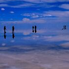 People walking on water in Salar de Uyuni, Bolivia by Camila Gelber