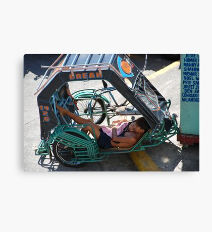 A boy and his sister sleeping in a bicycle Canvas Print