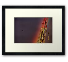 Helicopter flying into a rainbow Framed Print