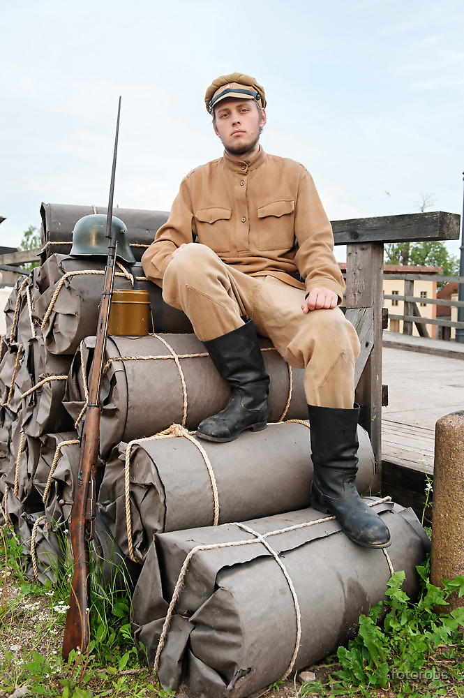 Retro style picture with soldier sitting on the bundles by fotorobs