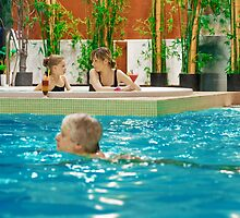 Family in swimming-pool by fotorobs