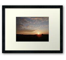 Distant Grainan sunset Framed Print