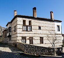 Traditional house at corner of the street by Tania Koleska