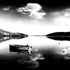 Black and white boat in Kastoria lake (Makedonia, Greece) by Tania Koleska
