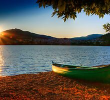 canoe cayak at lake into Sunset by Tania Koleska