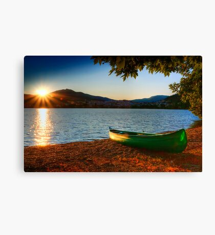 canoe cayak at lake into Sunset Canvas Print