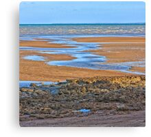 Rocks on beach at low tide Canvas Print