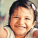 Three year cute girl running with paints on her hands by Neha Singh