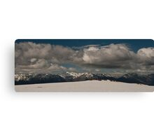 Clouds, mountains and snow Canvas Print