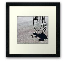 Penny-farthing shadow Framed Print