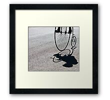 Penny-farthing shadow Framed Print