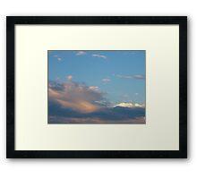 Accordion clouds Framed Print