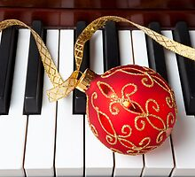 Christmas ornament on piano keys by Garry Gay