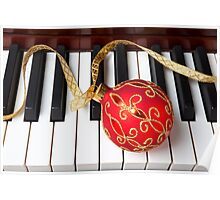 Christmas ornament on piano keys Poster