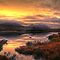 Golden Sunrise Over Loch Ba by Aj Finan