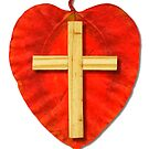 Small wooden cross on red leaf by queensoft