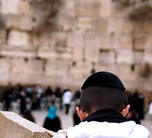 praying boy at wailing wall by johnnabrynn