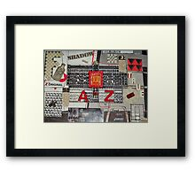 What's Black & White and Red all over? Framed Print