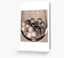 Several Marbles in a Wine Glass Greeting Card
