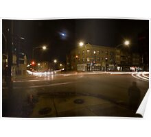A busy intersection with a full moon Poster