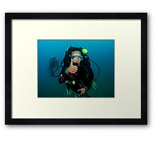 scuba diver demonstrates the sign language for divers. Framed Print