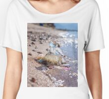 A bottle with seashells embedded in the sand on the beach  Women's Relaxed Fit T-Shirt