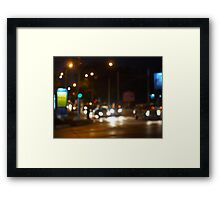 Abstract colored lights from moving vehicles Framed Print