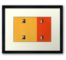 Four tiny windows on a yellow and orange wall Framed Print