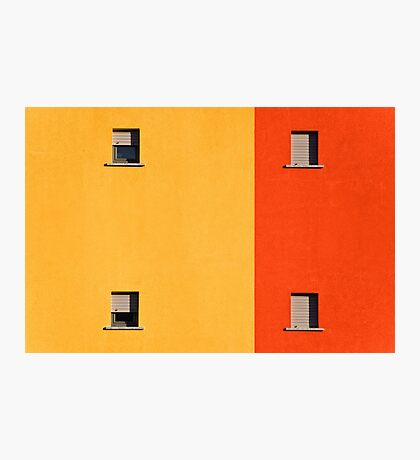 Four tiny windows on a yellow and orange wall Photographic Print