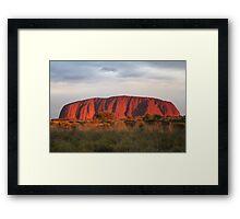 Setting sun shines on Uluru Framed Print