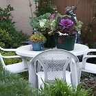 Summer dining tables and chairs by Sandra Foster