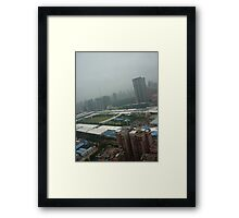 A soccer pitch surrounded by giants Framed Print