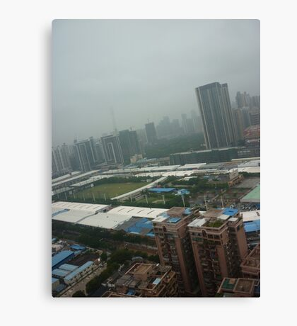 A soccer pitch surrounded by giants Canvas Print