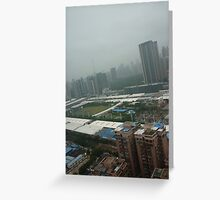 A soccer pitch surrounded by giants Greeting Card