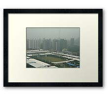 Soccer pitch surrounded by smog Framed Print