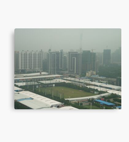 Soccer pitch surrounded by smog Canvas Print