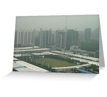 Soccer pitch surrounded by smog Greeting Card