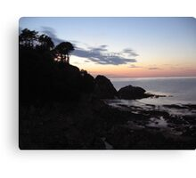 Lee Bay as the sun sets on a mid summers evening. Canvas Print