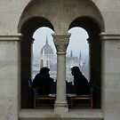 View of Parliament Buildings in Budapest, Hungary... silhouetted coffee drinkers by bethischeery
