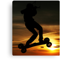 Kiteboarder flying through the Sunset. Canvas Print