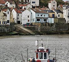 Fishing vessel in Staithes Harbour by Guy Carpenter