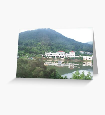 Mountain towering over museum in front of calm lake Greeting Card
