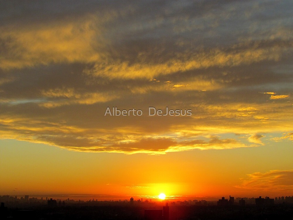 Rooftops, clouds and sun - New York City  by Alberto  DeJesus