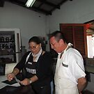 Female teacher and her pupil in a printing workshop, Puerto Vallarta by PtoVallartaMex